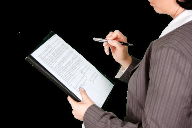 person wearing grey dress shirt holding black push pen