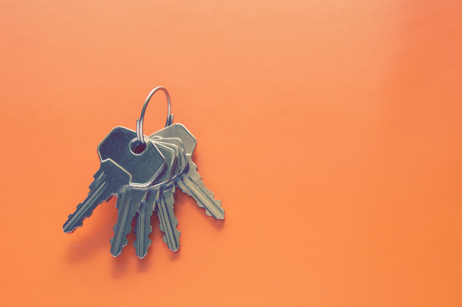 photography of keys on orange surface